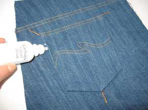 "9. Hem your pocket. I used a blind hem foot and a 1/4"" foot for the hem. Glue the pocket to the jeans. Press the glue dry."