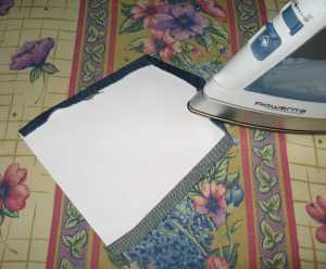 3. Press the edges of the pocket over a heavy paper template.