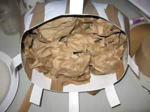 dress form stuffed with crumpled paper