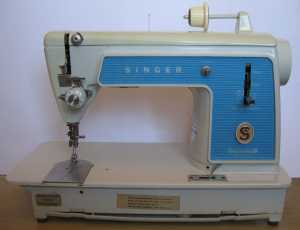Singer 604E sewing machine with chain stitch attachments