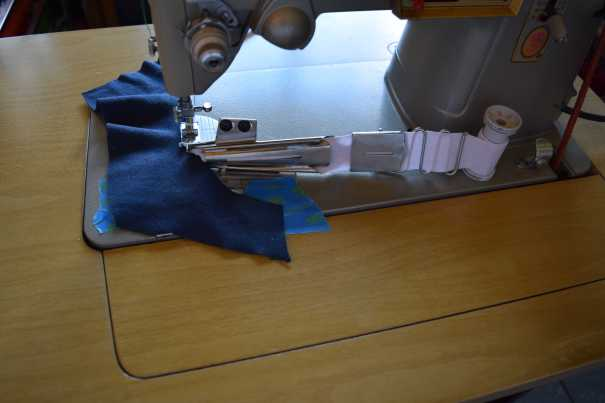 Position coverstitch binder on sewing machine